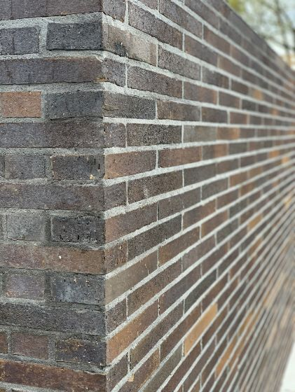 Low profile bricks laid in a brick fence in cairns with a rough texture